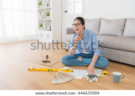 Beautiful Sweet Female Interior Design Engineer Thinking Drawing Inspiration Idea And Sitting In Living Room Wooden