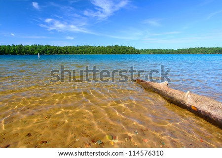 Beautiful swimming beach of Buffalo Lake in the Northern Highland American Legion State Forest of Wisconsin - stock photo
