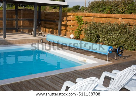 Beautiful swimming pool in the garden in the park.