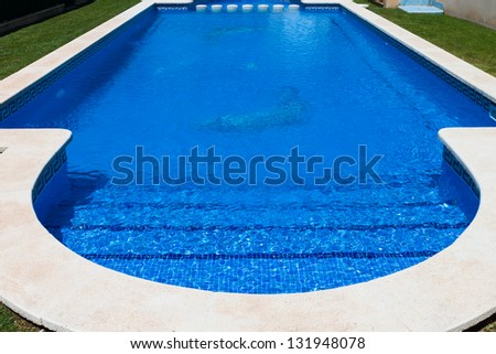 beautiful swimming pool with blue water - stock photo