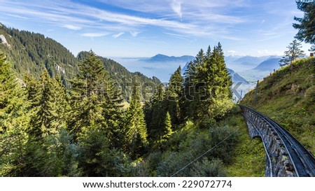 Beautiful Swiss Alps landscape with trail line to Mt. Pilatus  - stock photo