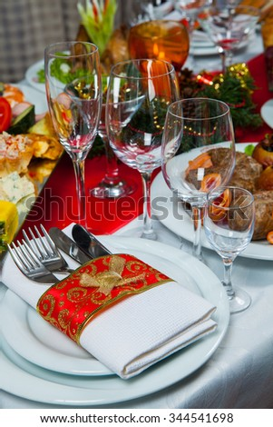 Beautiful table setting for Christmas party or New Year celebration Beautiful Christmas table setting.Christmas themed dinner table. New Year party table.