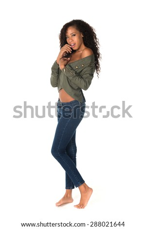 Beautiful tall multiracial woman in green jacket and jeans - stock photo