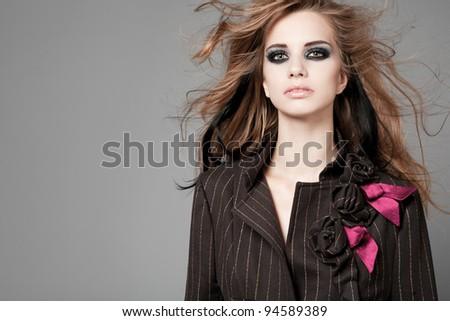 Beautiful tall slim model fashion model posing on gray background. - stock photo
