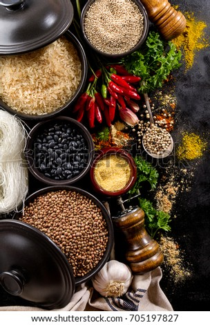 Beautiful Tasty Appetizing Ingredients Spices Grocery for Cooking Healthy Kitchen. Dark Black Background Horizontal Toning Copy Space