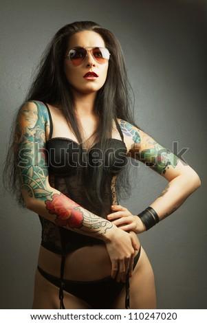 beautiful tattooed girl. brunette - stock photo