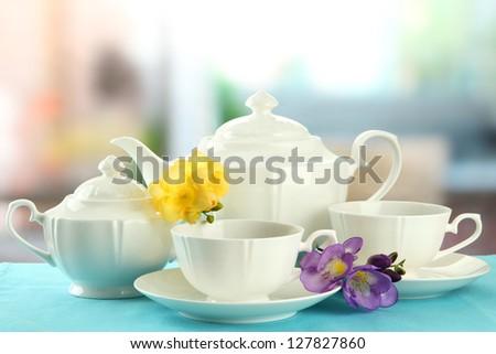 Beautiful tea service on table - stock photo