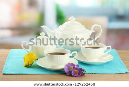 Beautiful tea service on wooden table - stock photo