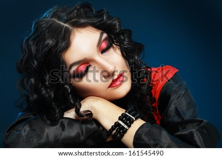 Beautiful teen fashion model close-up Portrait. Vampire girl sleeping