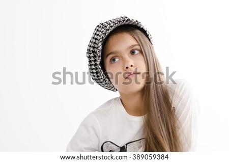 Beautiful teen girl. beauty woman portrait,  Teen girl beautiful cheerful with clean skin. schoolgirl with long hair in checkered cap. - stock photo