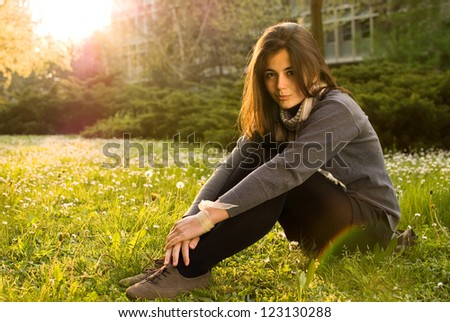 Beautiful teen girl enjoying in nature - stock photo