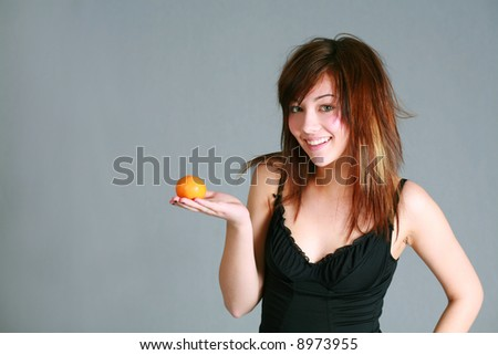 beautiful teen girl holding an orange