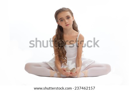 beautiful teen girl in white clothes  ballet pose with long hair isolated on white background
