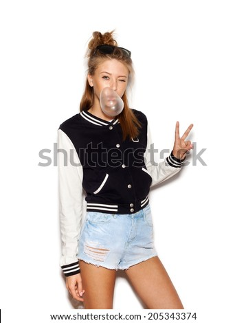 Beautiful teen girl inflating bubble of chewing gum. Modern fashion girl.  White background, not isolated - stock photo