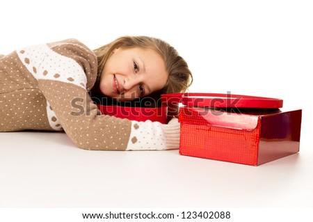 Beautiful teen girl lies beside gifts - stock photo
