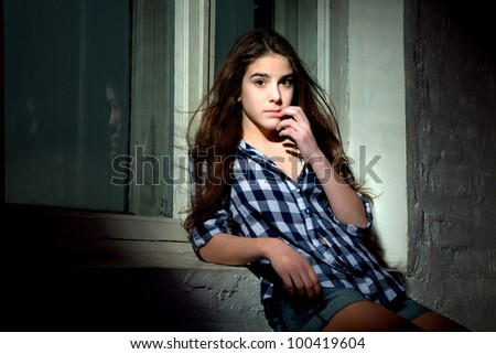 Beautiful teen girl near the window - stock photo