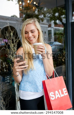 beautiful teen girl shopping in city standing outdoors with mobile cell phone - stock photo