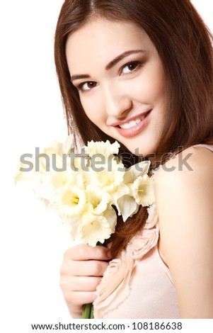 beautiful teen girl smiling and with flower narcissus and looking at camera. isolated on white - stock photo
