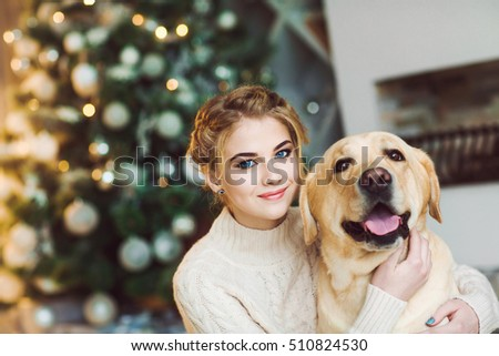 Beautiful teen girl with a labrador dog