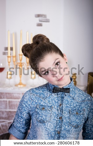 Beautiful teen girl with curly hairstyle. unusual hairstyle for teen at graduation. cheerful teen girl in the interior - stock photo