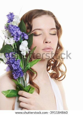 beautiful teen girl with flowers.isolated tenderness spring beauty young woman