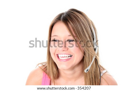 Beautiful teen girl with headset and big smile over white. Great for teen hotline or just gossiping with friends.