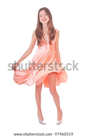 beautiful teen girl with  pink dress smiling