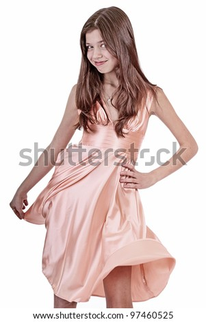 beautiful teen girl with  pink dress smiling - stock photo