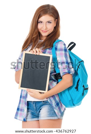 Beautiful teen girl with small blackboard and school bag, posing on white background