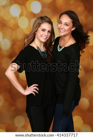 beautiful teen girls on gold bokeh background