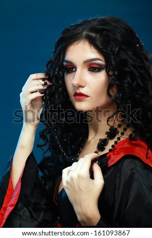 beautiful teen model with night vampire style with perfect make up