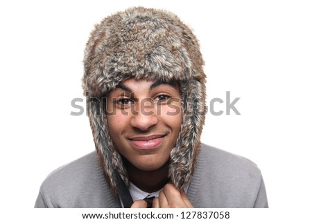 Beautiful teen with a furry hat - stock photo