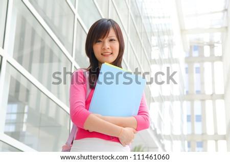 beautiful teenage asian college girl - stock photo