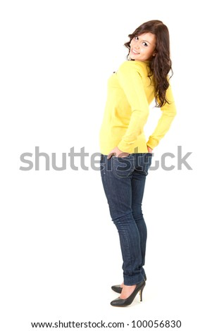 beautiful teenage gir looking at camera, full length, white background