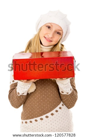 beautiful teenage girl in winter hat with a gift - stock photo