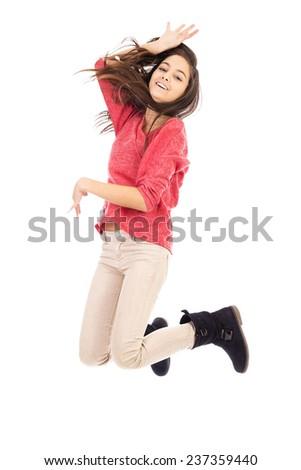 Beautiful teenage girl jumping isolated on white background  - stock photo
