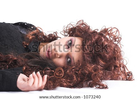 Beautiful teenage girl lying on the floor with her head turned towards camera