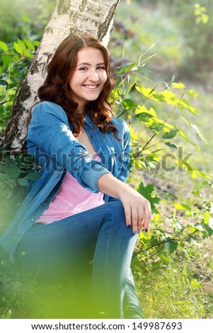 beautiful teenage girl portrait outdoor with copyspace