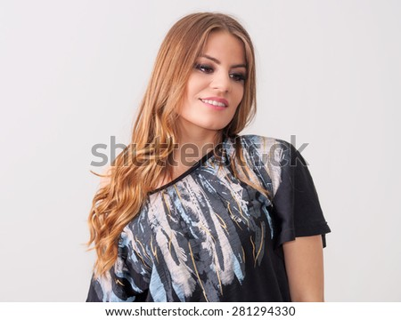 Beautiful teenage girl posing in a black t-shirt - stock photo