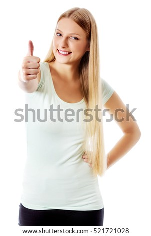 Beautiful teenage girl smiling and doing the thumbs-up sign.