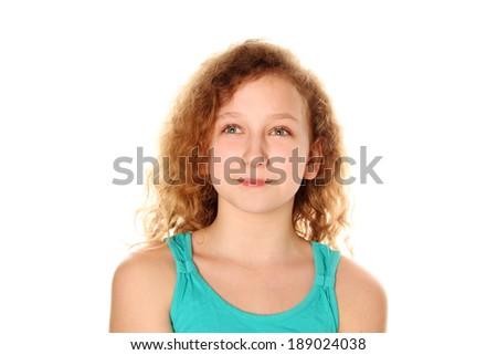 Beautiful teenage girl smiling on white background - stock photo