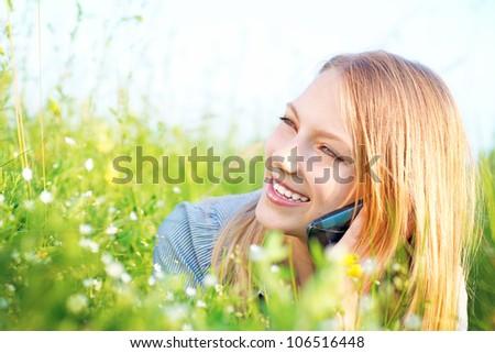 Beautiful Teenage Girl talking on the Phone outdoors - stock photo