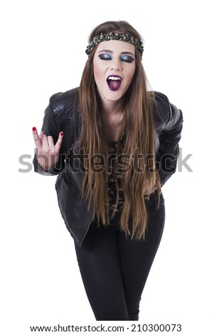 Beautiful teenage girl wearing black leather jacket having fun gesturing rock on isolated on white