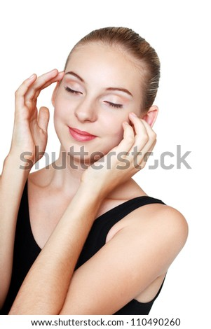 beautiful teenage girl with perfect skin touching her face by hands and enjoying clear skin. Isolated on white background