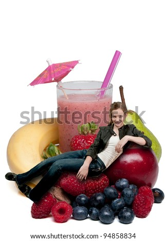 Beautiful teenage woman sitting with a delicious cold Fruit Smoothie or virgin daiquiri and fruit - stock photo