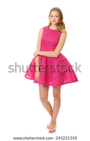 Beautiful teenage woman with pink skirt - stock photo