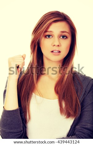 Beautiful teenage woman with shock expression - stock photo