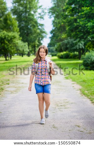 Beautiful teenager girl in casual clothes going to school on sunny september day, outdoor portrait - stock photo
