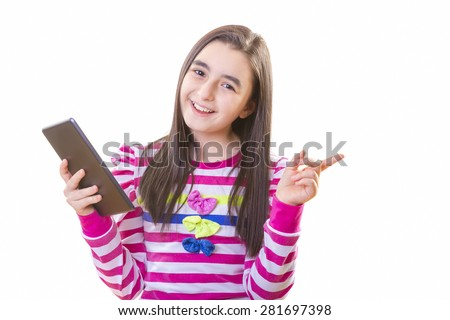 Beautiful teenager girl in casual clothes holding digital tablet in her hand - stock photo