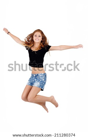 Beautiful teenager girl jumping, running isolated on white background  - stock photo